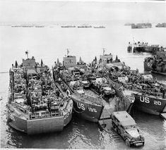 The Final Embarkation: Three US Navy LCTs (Landing Craft Tank) of either or US Infantry Divisions loaded with men and equipment at Portland, England, June Us Navy, Normandy Beach, D Day Landings, Landing Craft, Ww2 Pictures, Royal Air Force, Military History, Naval History, Dioramas