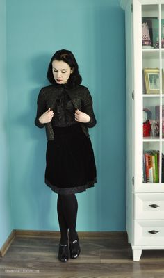 A gothic take on the cardigan paired with an A-line skirt and mary-janes.