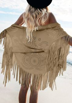 Back view of model in brown laser-cut suede cover up