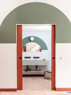 red pocket doors in room at menorca experimental resort. / sfgirlbybay