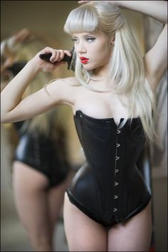 Miss Mosh in just a corset. So simple and yet so beautiful.