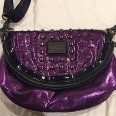 Betseyville Cross body Studded Purse Betsey Johnson Betseyville cross body clutch bag purse.  Lightly used, in great condition! Sparkly purple with slate gray studs and black adjustable and removable strap. Measures about 6x10 Betsey Johnson Bags Crossbody Bags