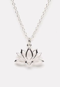 "The beauty of nature captured in sterling silver! This sterling lotus blossom flower pendant hangs from a sterling silver chain in an 18"" length with lobster clasp closure. Buddhists liken the unfoldi"