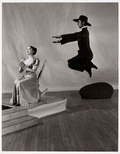 """Arnold Eagle, """"Appalachian Spring,"""" 1945 1944 - Library of Congress - Martha Graham Dance Company, Aaron Copland's ballet Appalachian Spring = a newlywed couple building a farmhouse 19th century PA, a revivalist preacher and his followers. Arnold Eagle's photograph captures the spirit of Copland's musicThe sets—istrange, striated boulder are by Japanese artist Isamu Noguchi."""