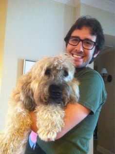 When even the cuteness of this dog couldn't overwhelm the perfection of Josh's coif. | Josh Groban's 16 Most Important Hair Moments