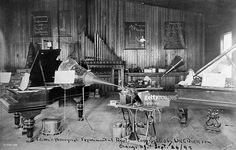 "American Gilded Age inventor: Thomas Alva Edison, (1847 - 1931) ~ Image: ""Edison's Phonograph Experimental Department"". Location: Orange, NJ - September 24th, c.1892.  Edison's experimental 'talking doll' invention, is sitting on the piano. ~ {cwlyons} ~ (Getty Images)"