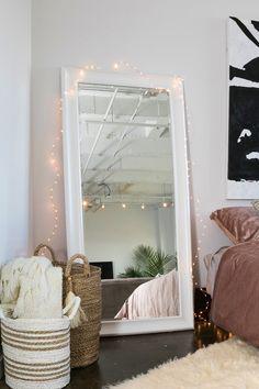 Midtown Loft: white floor mirror, fairy lights #wakeandloom