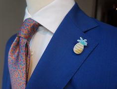 It's delicious weather. Ad a twist to your suit with lapel pins.