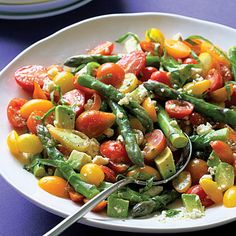 Cherry tomatoes and asparagus combine in this salad to make the perfect summer supper.