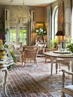 Déco ♦ Floor brick, nice degree of whitewash,wonderful windows with shutters,furniture is great for French country feel. Lighting is essential.