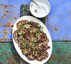Griddled aubergine salad with sultanas & pine nuts. A simple vegetarian side or main course salad drizzled with sweet honey dressing and served with Greek yogurt
