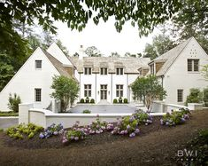 Love the rooflines and white... Looking for lower look in front... Buckhead Manor by Beth Webb Interiors