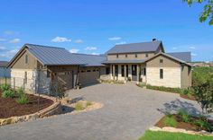 This timeless farmhouse style home is designed by Geschke Group Architecture and Arbogast Custom Homes, located in Lakeway, Texas. Rustic Houses Exterior, Modern Farmhouse Exterior, Modern Farmhouse Style, Texas Ranch Homes, Ranch Style Homes, German Architecture, Architecture Design, Off Grid House, Hill Country Homes