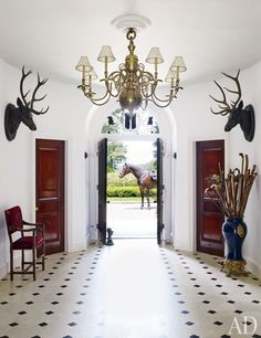 At Lauren's residence in Bedford, New York, a 19th-century Dutch chandelier presides over the entrance hall.