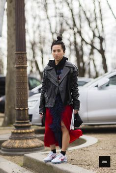 Olivia Kim wearing a leather jacket and nike vapor max sneakers during Paris Fashion Week Fall Winter 2017