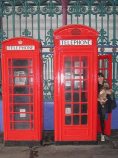 a k2 and k6 telephone kiosk standing next to one another with Jacqui standing in the K2 booth