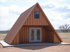 A-frame Cabin House ; w/all metal roof exterior.