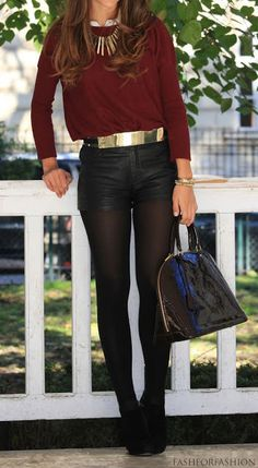 in the winter, pair your leather shorts with tights and a sweater, and cinch the look with a bold belt