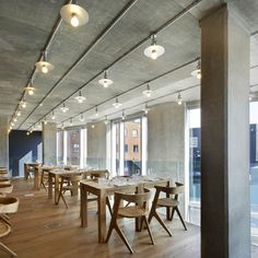 Nottingdale Cafe by Found Associates - i love the big open space, industrial yet warm lighting and the cement columns, ceiling & walls....