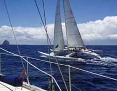 A cruising trimaran at speed. Multihull sailboats need no ballast to keep them upright, making them light and fast. Unlike cruising catamarans with their cavenous interiors, trimarans tend to be rather cramped and spartan below.