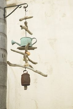 """How to Make a Wind Chime from Recycled Objects. The green movement has touched many aspects of culture, some as large as constructing more environmentally friendly buildings and some as small as using a reusable tote when grocery shopping. Craft projects can be green as well with an emphasis on """"found"""" object art. You can upcycle your..."""