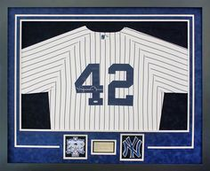 Yankees jersey with patch, plate, and custom cut Yankees cutout, preserved in a classic black frame with silver and blue suede mat boards.  Designed and framed at Art & Frame Express in Edison, NJ.