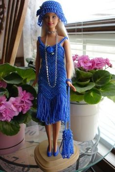 check out this hand crocheted barbie doll and outfit made by my sister!! Amazing detail, check out her store for some wonderful handmade porcelain dolls she is selling.  She has run out of room in her home. Amazing dolls.