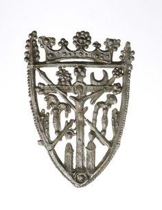 Title:  Pewter pilgrim badge: 15th century    Description:  Shield-shaped pilgrim badge. It has an openwork design depicting the crucifixion and instruments of Christ's passion.