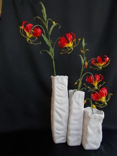{Terrific presentation of gumpaste Flame Lilies by tortedinadia}