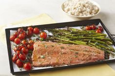 Gather one pan, one salmon fillet and one pound of asparagus for the salmon supper of your dreams. One-Pan Roasted Salmon Supper is great for weeknights. Salmon Recipes, Fish Recipes, Seafood Recipes, Cooking Recipes, Healthy Recipes, Cooking Ideas, Easy Meal Prep, Easy Meals, Fresh Asparagus
