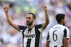 Juventus' Argentinian forward Gonzalo Higuain celebrates After scoring a goal…