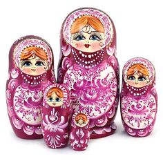 """Matryoshka """"Ruby Flowers""""   - An exclusive nesting doll, handcrafted by the artist to win the heart of anyone, who sees it! Traditionally, nesting doll faces are painted without over-saturating them with details, in order to create a generalized image of a beautiful girl with big, beautiful eyes and rosy cheeks."""