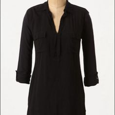 Black button down shirt  http://www.anthropologie.com/anthro/catalog/productdetail.jsp?id=23807183&catId=CLOTHES-KNITSTEES&pushId=CLOTHES-KNITSTEES&popId=CLOTHES&navCount=35&color=060&isProduct=true&fromCategoryPage=true&isSubcategory=true&subCategoryId=CLOTHES-KNITSTEES&templateType=subCategory