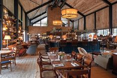 Soho House & Co's in-house design team and London architects Michaelis Boyd have overhauled a run-down farm in Oxfordshire to create Soho Farmhouse Farmhouse Restaurant, Farm Restaurant, Restaurant Design, Soho House Restaurant, Restaurant Fireplace, Farmhouse Brewery, Restaurant Ideas, Soho House London, London Eye