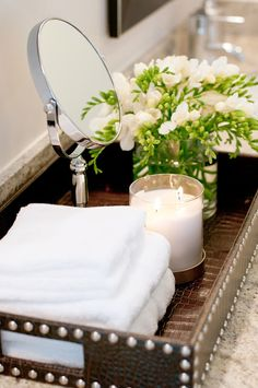 Powder Room - Accessorizing with class - tip towels, hand mirror, scented candle and fresh flowers....classic essentials.