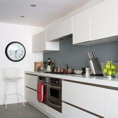 Modern white kitchen with glass splashbacks in smart grey