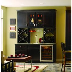 interior space design provides personalized storage with exterior aesthetics. Pull-out shelves, roll-out pantry drawers, built-in wine racks and cookware organizers are part of the cabinet maker's Zoned Organization solutions.