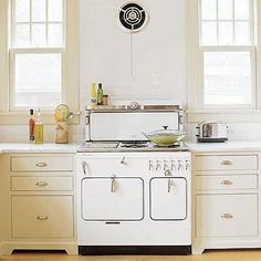 The 1947 Chambers range inspired this kitchen design. Above it, a vintage exhaust fan.