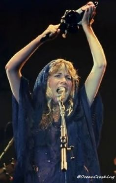 Stevie in action onstage, her tambourine held high over her head, and wearing a navy chiffon shawl partly on her head and partly on her shoulders   ~ ☆♥❤♥☆ ~