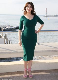 Making them green with envy: Nigella Lawson ensured her famed figure was on full display as she made an appearance at MIPCOM - an annual television trade show held in Cannes, France - on Monday afternoon