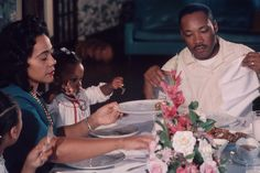 Rare color photograph of the King family eating dinner together. (Photo source unknown)