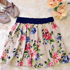 """HOST PICK  Floral Skirt Floral skirt with elastic waist. Length is 15"""" from top. The colors are cream with a navy waist band and pink and blue floral print BONGO Skirts Mini"""
