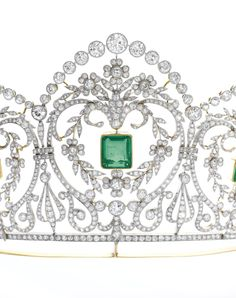 Detail from Emerald and diamond tiara, circa 1910 Of floral, foliate and garland design, millegrain-set with step-cut emeralds, circular-, single-cut and cushion-shaped diamonds, French assay and maker's marks.
