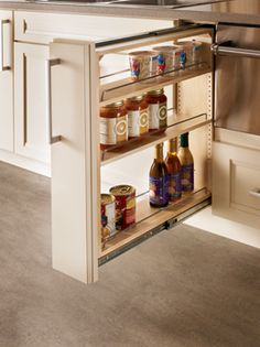 "Base Filler Pull-out.  A slim cabinet that's big on storage. Fits in space meant for 3"" filler and offers three storage shelves for spices and more. Great next to your cooktop.  Available at JustCabinets.com"