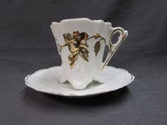 Antique Porcelain Coffee Cup and Saucer. This little coffee cup and saucer are white porcelain with gold decor.