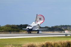 With its drag chute unfurled, Space Shuttle Discovery STS-133 rolls down Runway 15 at the Shuttle Landing Facility at NASA's Kennedy Space Center in Florida on March 9, 2011. This was Discovery's 39th and final mission. NASA Image.