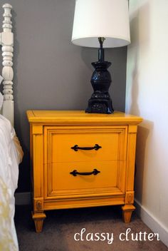 Classy Clutter: Can I just say how much I LOVE this blog. This roomm re-do is one of my favorites, and this yellow nightstand? LOVE LOVE LOVE. I have a vintage one that may just turn this color...that or red. I just love how bold this piece is.