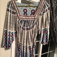 American Rag Boho peasant top Floral patterned boho peasant top. 3/4 sleeves, flowy fit with breaded belt. Embroidered neckline. American Rag Tops Blouses
