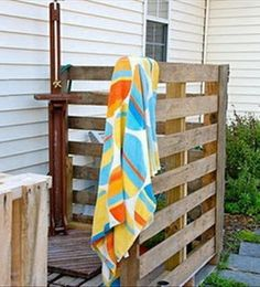 An outside privacy shower area made from 2 wood pallets