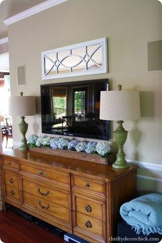 Love this look- dresser as entertainment stand... box of hydrangeas (source: Thrifty Decor Chick)